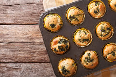 Fresh from the oven muffins with spinach and feta cheese close-u Stock Photography