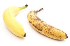 Fresh and overripe bananas on white background Stock Image