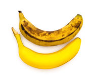 Fresh and overripe bananas on white Royalty Free Stock Image