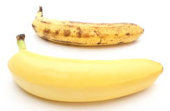 Fresh and overripe bananas on white background Royalty Free Stock Images
