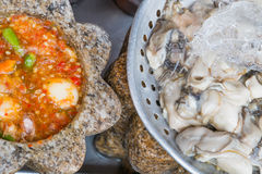 Fresh oyster in ice. And seafood sauce Stock Photo