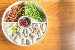 Fresh oyster with vegetables. On plate Stock Image
