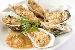 Fresh oysters with garlic sauce Stock Image