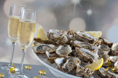 Fresh oysters with glass of champaigne. Fresh oysters and champaigne for festive dinner party Royalty Free Stock Image