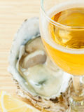 Fresh oysters with lemon and a glass of wine. Royalty Free Stock Photos