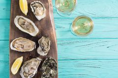 Fresh Oysters with lemon and white wine. Seafood background royalty free stock photo