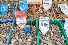 Fresh oysters for sale. Crates with fresh oysters for sale at the french coast of Brittany Bretagne in Cancale, France, on August 1, 2014 Stock Image