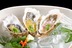 Fresh Oysters with three sauces. (cilantro with lime juice, ginger vanilla and pinneaple with chili Royalty Free Stock Photos