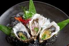 Fresh Oysters with three sauces. (cilantro with lime juice, ginger vanilla and pinneaple with chili Stock Photography