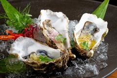 Fresh Oysters with three sauces. (cilantro with lime juice, ginger vanilla and pinneaple with chili Royalty Free Stock Photo