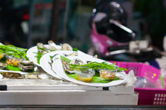 Fresh oysters in a white plate. At night market,Thailand Stock Image