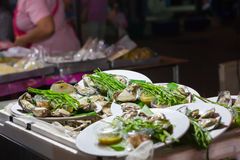 Fresh oysters in a white plate. At night market,Thailand Stock Photos