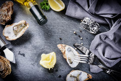 Fresh oysters with white wine and lemon on stone background Royalty Free Stock Photography