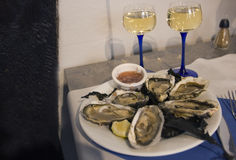 Fresh oysters and wine. French cuisine. Stock Image