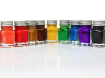 Fresh Paint. Row of colorful model paint jars on white Stock Photo