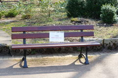 Fresh painted bench. Wooden bench with sign saying fresh painted stock photography