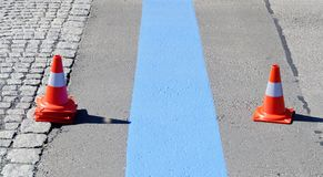 Fresh painted blue line for short-term parking zone Stock Images