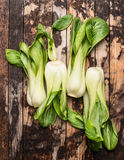 Fresh pak choi on rustic wooden background Royalty Free Stock Images