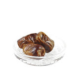 Fresh Palm Dates. A serving a fresh dates on a glass dish during the muslim fasting month of Ramadan, isolated against white royalty free stock photography