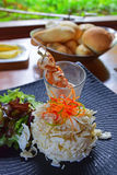 Fresh Palm Salad with Prawn Skewers in a glass with warm bread and butter in background Stock Photo