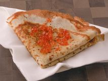 Fresh pancake with red caviar on a plate with a white napkin stock photography
