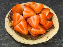 Fresh Pancake With Sliced Ripe Juicy Strawberries and Chocolate Spread Royalty Free Stock Photography