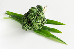 Fresh Pandanus leaf weave to rose bouquet Stock Photo