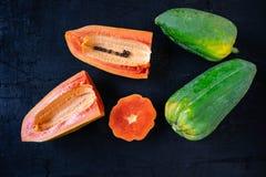 .Fresh papaya on black background stock image