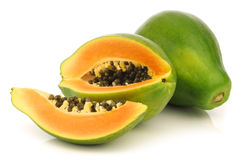 Fresh papaya fruit and a cut one Royalty Free Stock Photos