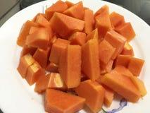 Fresh papaya. Pieces of papaya on the plate