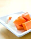 Fresh papaya with plain yogurt Royalty Free Stock Photo