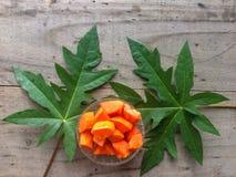 Fresh papaya sliced in bowl with leaf. stock photo