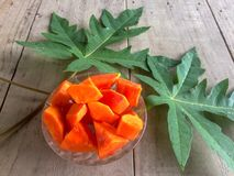Fresh papaya sliced in bowl with leaf. stock photography