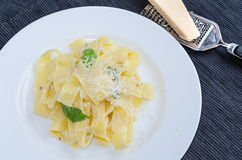 Fresh pappadelle pasta with lemon, basil and creame Royalty Free Stock Photos
