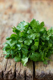 Fresh parsley. On wooden surface Royalty Free Stock Photography