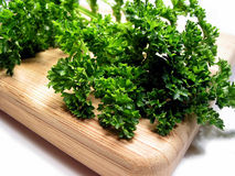 Fresh parsley on cutting board royalty free stock image