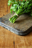 Fresh parsley on an old chopping board Royalty Free Stock Image