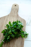 Fresh parsley on wooden cutting board Royalty Free Stock Photography