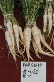 Fresh parsnip at a farmers market royalty free stock photo