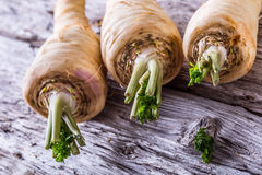 Fresh parsnip on old wooden table. Stock Photography