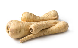 Fresh parsnip roots. On a white background Royalty Free Stock Photo