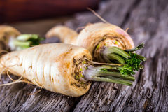 Fresh parsnips on old wooden table. Royalty Free Stock Images