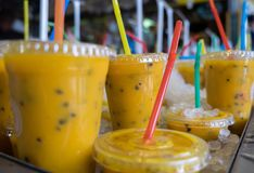 Fresh passiflora juice in ice at farmers market. Fresh passiflora juice in ice for sale at farmers market stock photo