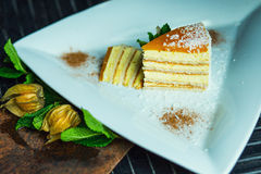 Fresh passion fruit cake with coconut and cinnamon. Dessert on plate. The restaurant or cafe atmosphere Royalty Free Stock Image