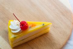 Fresh passion fruit cake dessert on wooden plate royalty free stock images