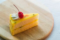 Fresh passion fruit cake dessert on wooden plate royalty free stock photo