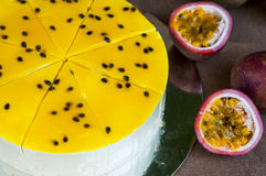Fresh passion fruit cheesecake on the background. Passion fruit cheesecake on the background Stock Photography