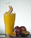 Fresh passion fruit juice splash Stock Image
