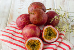 Fresh passion fruit. On white wood Royalty Free Stock Images