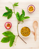 Fresh passion fruits set up on wooden background. Juicy passion Royalty Free Stock Image